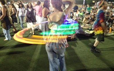 Working the glow-in-the-dark hula hoop (photo credit: Jessica Steinberg)