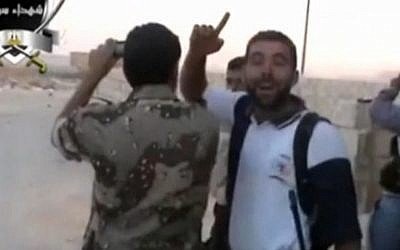 Syrian opposition fighters taking video or photo images of Syrian forces parachuting (photo credit: screenshot)