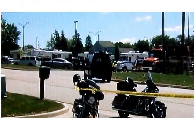 The scene outside a Sikh temple in Wisconsin where a shooting took place on Sunday. (photo credit: Image capture from YouTube video uploaded by wiseuppeopletv)