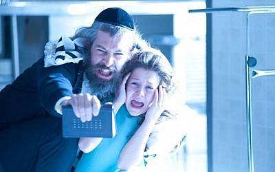 "A rabbi's son (Matisyahu) attempts to exorcise a dybbuk, or malevolent spirit, from a young girl (Natasha Calis) in Hollywood thriller ""The Possession"" (Photo credit: courtesy of Lionsgate)"