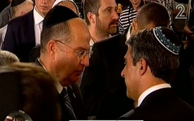 Moshe Ya'alon, left, at the memorial ceremony in Burgas on Tuesday. (Screenshot: Channel 2)