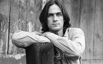 James Taylor in shirtsleeves, for the cover of Sweet Baby James (photo credit: Henry Diltz)