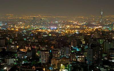 Tehran at night. (photo credit: CC BY farrokhi, Flickr)