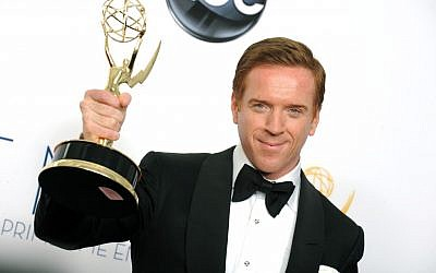 "Actor Damien Lewis, winner of the Outstanding Lead Actor In A Drama Series award for ""Homeland,"" poses backstage at the 64th Primetime Emmy Awards on Sunday, Sept. 23, 2012, in Los Angeles. (photo credit: Jordan Strauss/Invision/AP)"