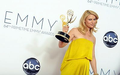 "Actress Claire Danes, winner of the Outstanding Lead Actress In A Drama Series award for ""Homeland,"" poses backstage at the 64th Primetime Emmy Awards Sunday, Sept. 23, 2012, in Los Angeles. (photo credit: Jordan Strauss/Invision/AP)"