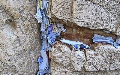 Prayers and notes in the cracks of the Western Wall (photo credit: CC-BY Yarin Kirchen/Wikipedia)
