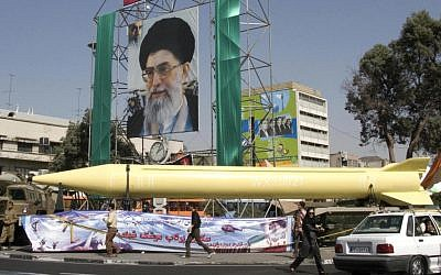 A military exhibition displays the Shahab-3 missile under a picture of the Iranian Supreme Leader Ayatollah Ali Khamenei, in Tehran, in 2008. (photo credit: AP/Hasan Sarbakhshian)