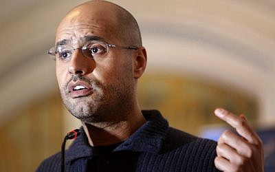 Saif al-Islam Gaddafi speaks to the media at a press conference in a hotel in Tripoli, Libya, in February 2011. The International Criminal Court prosecutor had asked judges to issue arrest warrants for Libyan leader Muammar Gaddafi and  son Saif, for crimes against humanity, accusing them of deliberately targeting civilians in their crackdown against rebels. (photo credit: AP Photo/Ben Curtis, file)
