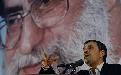 Then-Iranian president Mahmoud Ahmadinejad speaks in front of a portrait of supreme leader Ayatollah Ali Khamenei in 2012 (AP/Vahid Salemi)