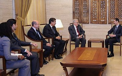 The new UN-Arab League envoy to Syria Lakhdar Brahimi, second from the right, meets with President Bashar Assad in Damascus on Saturday (photo credit: AP/SANA)