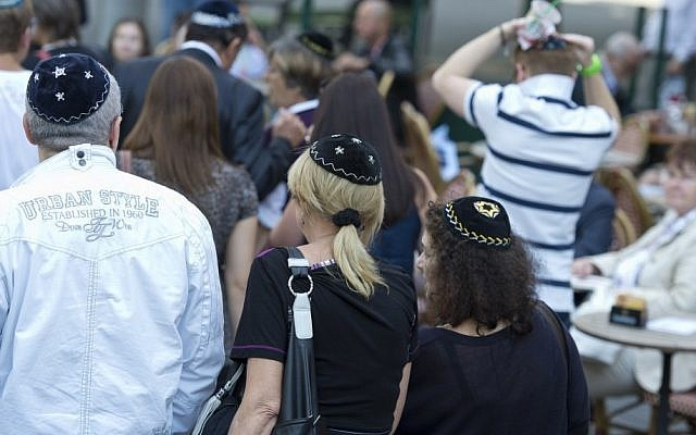 Berlin residents wear kippot in solidarity with a local rabbi who was brutally attacked in August 2013 (photo credit: AP/Michael Gottschalk)