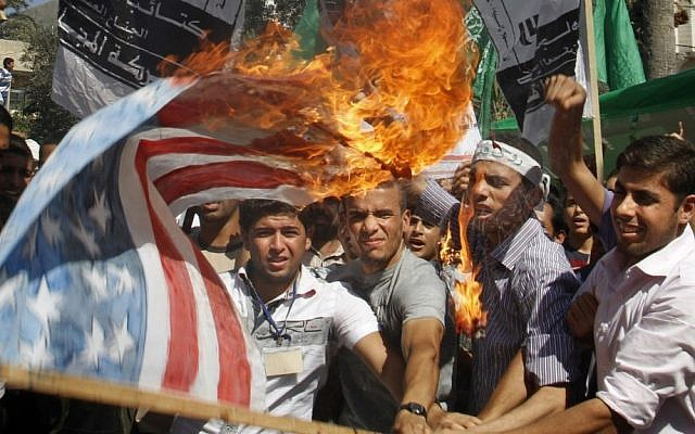 Palestinian Hamas supporters burn a US flag during a protest in Gaza City, Friday. (photo credit: AP)