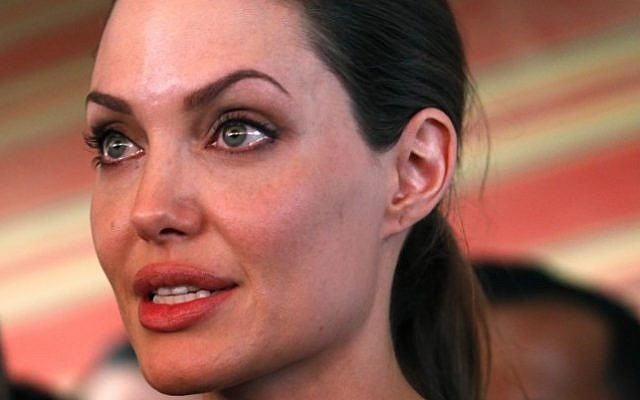 The UN refugee agency's special envoy, actress Angelina Jolie, speaks to the press during her visit to the Zaatari Syrian Refugees Camp, in Mafraq, Jordan, Tuesday, September 11, 2012.  (photo credit: Mohammad Hannon/AP)
