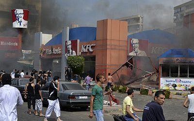 Lebanese protesters attack American fast food restaurants after Friday prayers, pouring petrol on the restaurants and setting them on fire in the northeastern city of Tripoli, Lebanon, Friday Sept. 14 (photo credit: AP Photo)