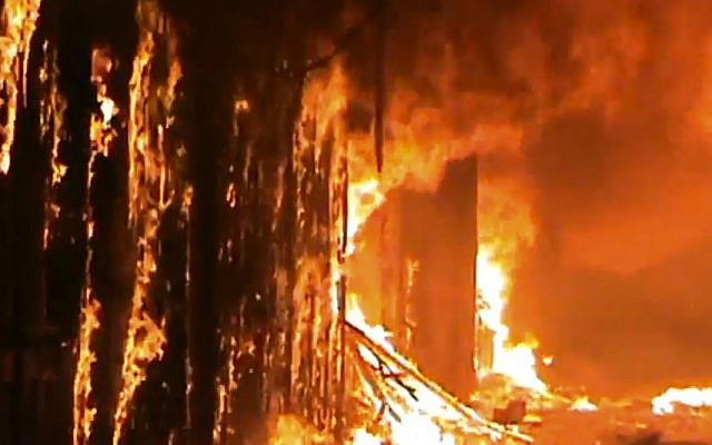 In this image taken from video obtained from Shaam News Network (SNN), which has been authenticated based on its contents and other AP reporting, a fire rages at a medieval souk in Aleppo, Syria. (photo credit: AP)