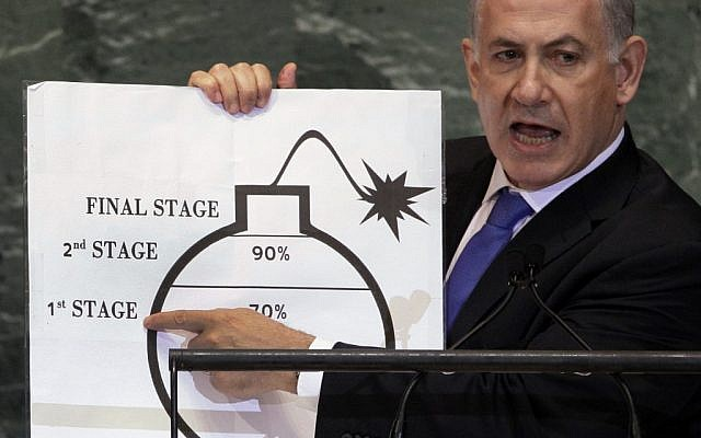 Prime Minister Benjamin Netanyahu shows an illustration as he describes his concerns over Iran's nuclear ambitions during his address to the 67th session of the United Nations General Assembly at UN Headquarters on Thursday, Sept. 27, 2012. (photo credit: Richard Drew/AP)