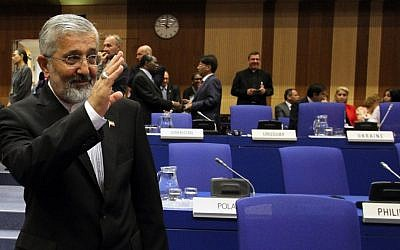 Iran's ambassador to the International Atomic Energy Agency Ali Asghar Soltanieh waves as he arrives for the IAEA board of governors meeting in Vienna on September 11, 2012 (photo credit: AP/Ronald Zak)