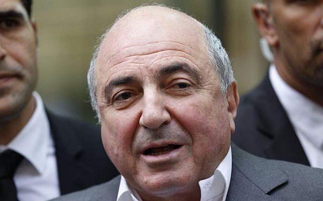 Russian tycoon Boris Berezovsky talks to the media after losing a case against Russian oligarch Roman Abramovich as he leaves the High Court in London, in 2012. (photo credit: AP)