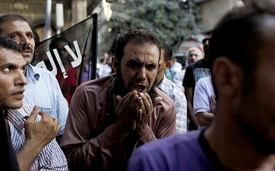 Egyptians protest outside the American embassy in Cairo, September 12 (photo credit: AP/Nasser Nasser)