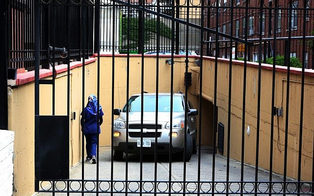 Embassy staff back a van into the underground garage at the Iranian embassy in Ottawa, Friday Sept.7, 2012 (photo credit: AP/The Canadian Press, Fred Chartrand)
