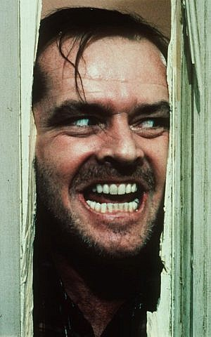Jack Nicholson portrays Jack Torrance in a scene from the movie 'The Shining.' (photo credit: AP Photo/Warner Bros. Inc., file)