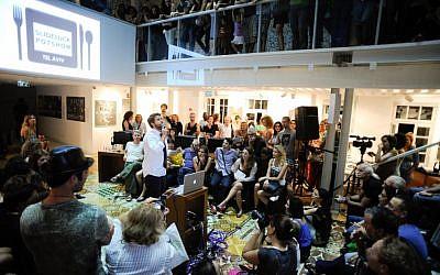 The first Slideluck Potluck in Tel Aviv (photo credit: Casey Kelbaugh)