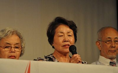 Sugino Nobuko, center, one of the Hibakushas visiting Israel, recounts her personal story of surviving an atomic bombing (photo credit: Michal Shmulovich/Times of Israel)