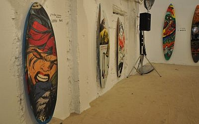 Some of the participating surfboards in the Surf Writers exhibition (photo credit: Michal Shmulovich)