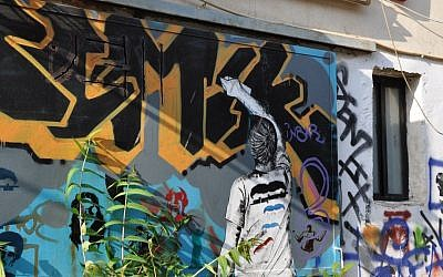 Street art, depicting an artist graffitiing, in south Tel aviv (photo credit: Michal Shmulovich/Times of Israel)