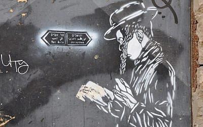 Street art depicting a Tel Aviv or Jerusalem road sign, in Florentin, Tel Aviv (photo credit: Michal Shmulovich)