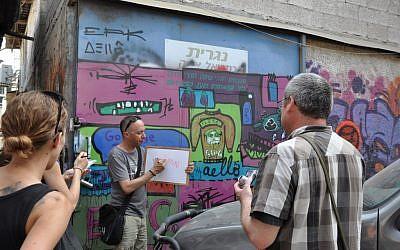 Guy Sharett on his graffiti street tour in Florentin, Tel Aviv (photo credit: Michal Shmulovich)