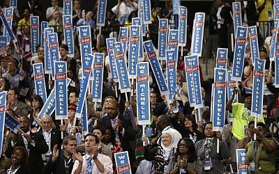 Delegates cheer as First Lady Michelle Obama addresses the Democratic National Convention in Charlotte, N.C., on Monday, Sept. 3, 2012. (photo credit: AP Photo/Charles Dharapak)