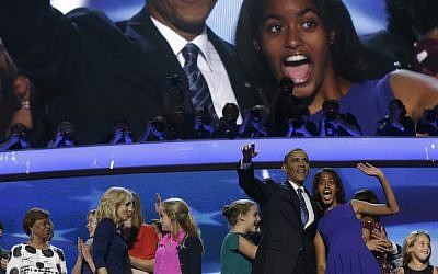 US President Barack Obama and daughter Malia wave to the crowd after the president's speech at the 2012 Democratic National Convention (photo credit: AP/Charles Dharapak)