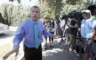 Los Angeles Sheriff's Department spokesman Steve Whitmore speaks to reporters outside the home of Nakoula Basseley Nakoula on Thursday (photo credit: AP/Nick Ut)