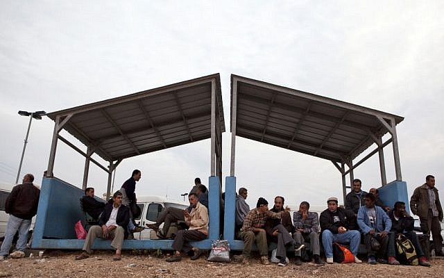 Palestinian workers at a checkpoint near Qalqilya in 2009. (Matanya Tausig/Flash90)