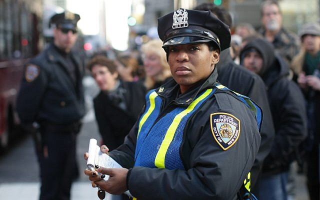 A policewoman stands guard in the middle of the street, in Manhattan, New York. (photo credit: Kobi Gideon/Flash 90)