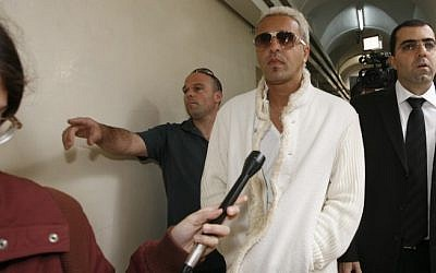 Singer Kobi Peretz brought to court in a tax fraud hearing, March 2010 (photo credit: Miriam Alster/Flash90)