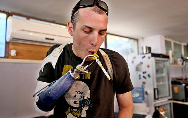 An injured IDF soldier uses medicinal cannabis (photo credit: Abir Sultan/Flash90)