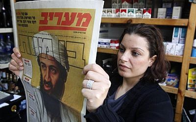 Maariv reports the death of Osama Bin Laden on May 3, 2011 (photo credit: Miriam Alster/Flash90)