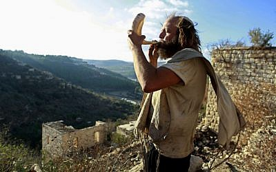 Blowing the shofar in Lifta, near Jerusalem (photo credit: Uri Lenz/Flash90)