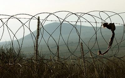 A barbed wire fence on the Syrian border. (photo credit: Moshe Shai/Flash90)