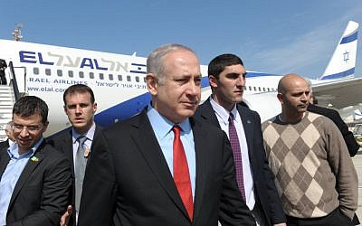 Benjamin Netanyahu returns from visits to Canada and the US in March 2012 (photo credit: Amos Ben Gershom/Flash90)