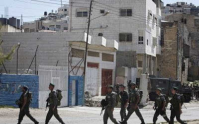 Soldiers patrol the streets of Hebron (illustrative photo credit: Miriam Alster/Flash90)