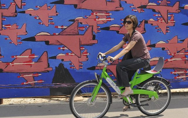 A woman rides a Tel-O-Fun bicycle in Tel Aviv. (photo credit: Serge Attal/Flash90)