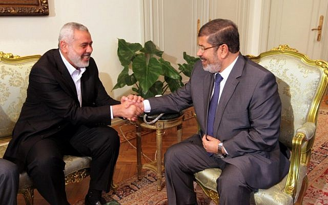 Hamas' Prime Minister in Gaza Ismail Haniyeh, left, meets with then-president of Egypt Mohammed Morsi in Cairo, July 2012 (photo credit: Mohammed al-Ostaz/Flash90)