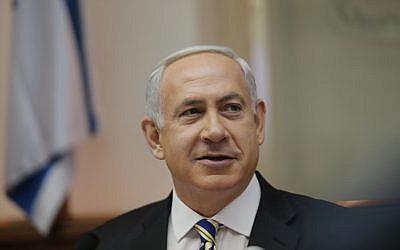 Binyamin Netanyahu attributes Israeli stability to the IDF (photo credit: Alex Kolomoisky/Pool/Flash90)
