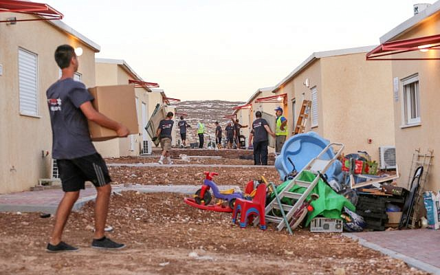 Movers help to evacuate the West Bank outpost of Migron last September (photo credit: Oren Nahshon/Flash90)