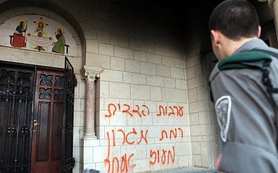 Graffiti sprayed on the Monastery of the Silent Monks at Latrun, Tuesday (photo credit: Yoav Ari Dudkevitch/Flash90)