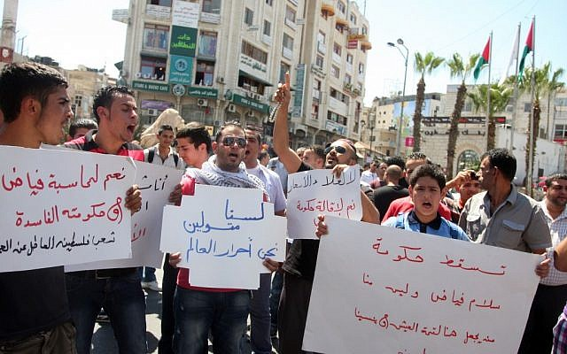 Palestinians demonstrate against the government of Salam Fayyad in Ramallah, September 5 (photo credit: Issam Rimawi/ Flash90)