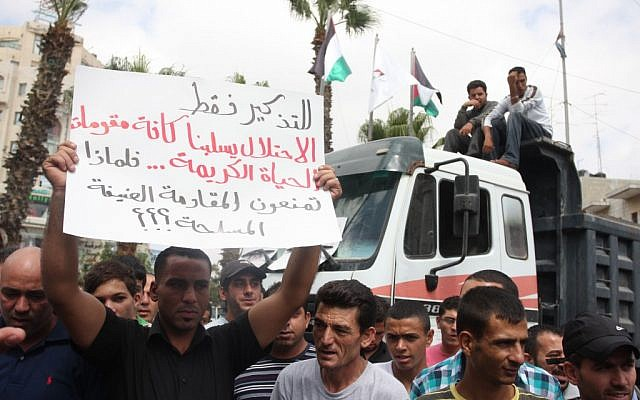 Palestinians demonstrate against the government in Ramallah, September 9 (photo credit: Issam Rimawi/ Flash90)
